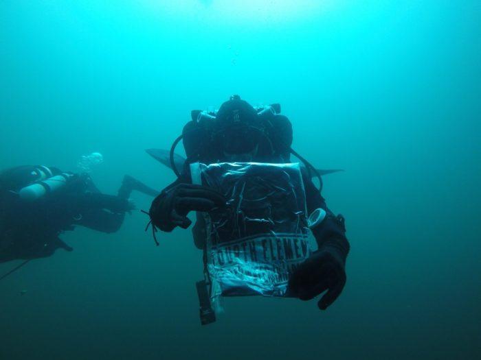 """Fourth Element  """"Underwater Inhabitants"""" Underwater With Their T-Shirt"""