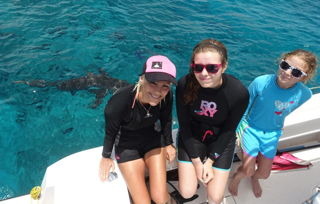 Jillian with the future marine biologist after their shark dive (Photo credit: Duncan Brake)