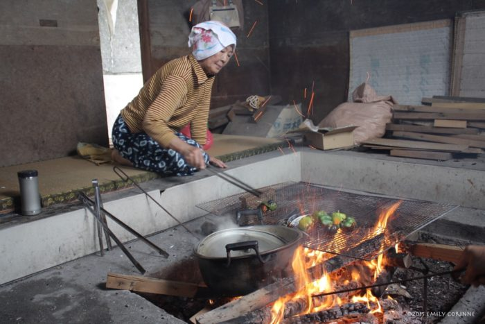 This is the real Ama goya, not the one seen by tourists. This Ama is cooking some peppers, sweet potatoes, and little fish as the other Ama prepare the catch of the day in the tourist restaurant.