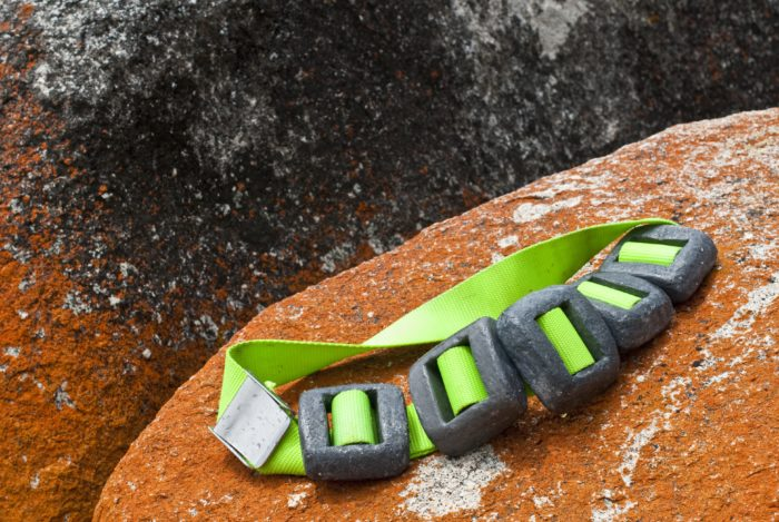 Scuba diver's lead weight belt on granite rock