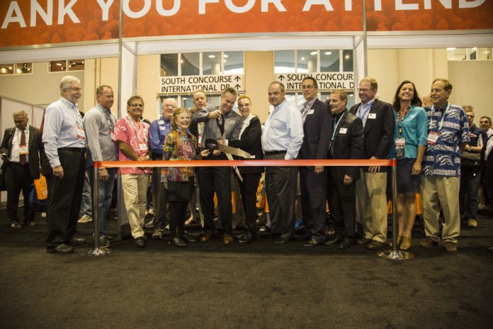 DEMA Executive Director Tom Ingram and other dignitaries officially open DEMA Show 2015.