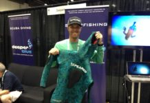 Speared Apparel's Aaron Chase shows off a prototype of his company's new spearfishing wetsuit
