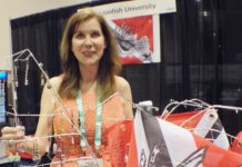 Stacy Frank, one of the founders of Lionfish University, with the speared lionfish dive flag she helped pioneer.