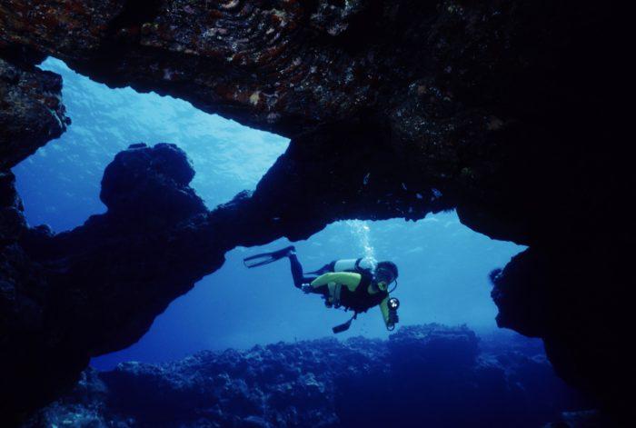 Scuba Diver Exploring a Cavern