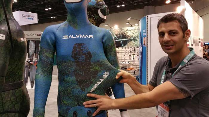 Maverick America's Petros Yiannikouros demonstrates the flexibility of the company's new Nebula.Skin wetsuit.