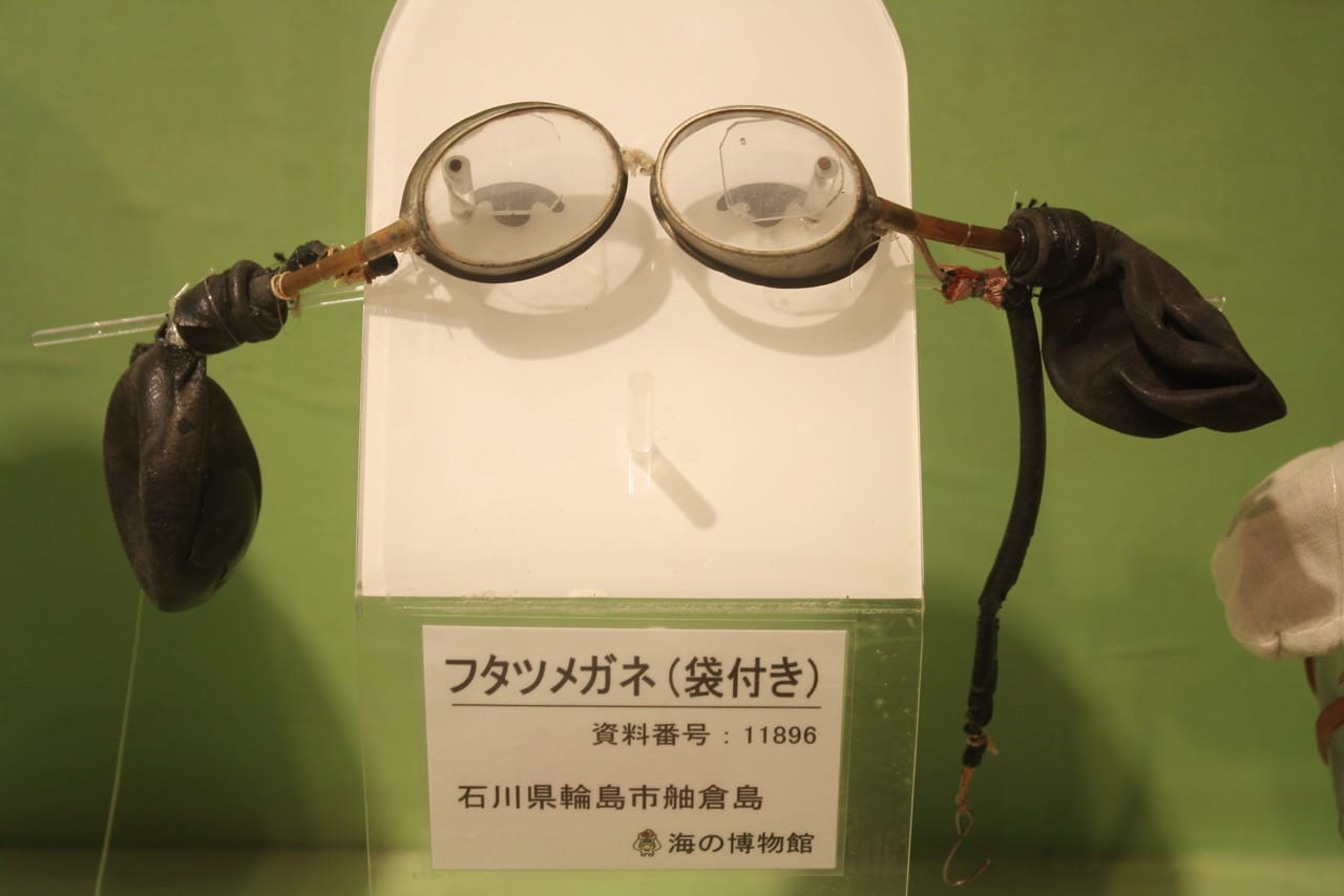 The first goggles (1878) were very basic with a special pressure release valve and eventually evolved into the large windowed, nose covering masks you see them wearing today.
