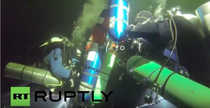 Russian Divers Break Record For Deepest Below-Ice Dive (Photo credit: Russia Today's RUPTLY video agency)