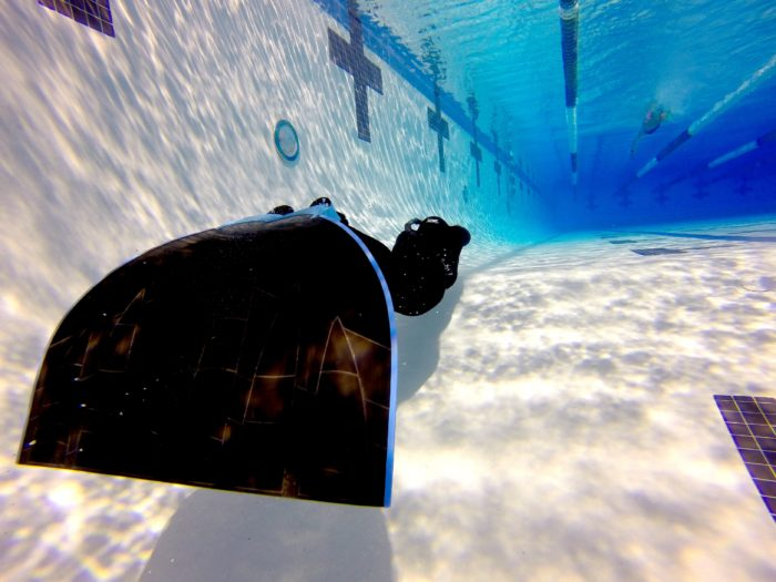 Freediver training in the pool with a monofin - Photo by Nathan Lucas