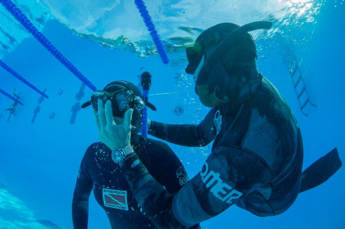 Students practice underwater rescue scenarios during a freediving course