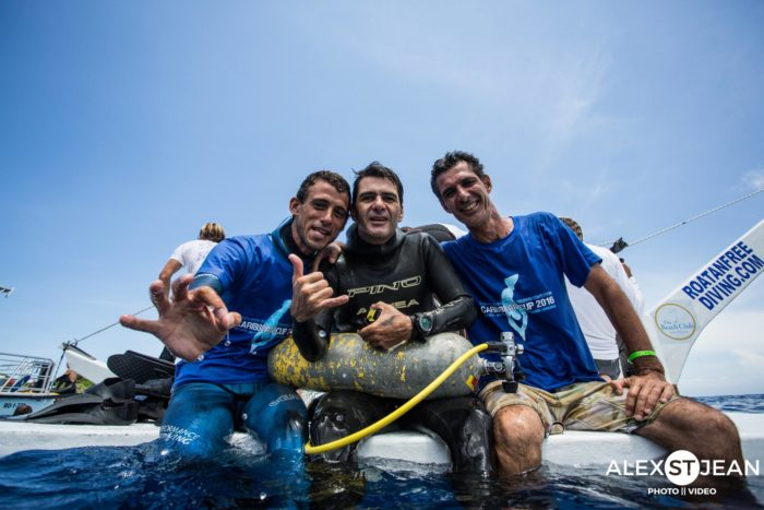 Alejandro Andres, pumped after his national record dive, flanked by Damian Scalfaro and Esteban Darhanpe.
