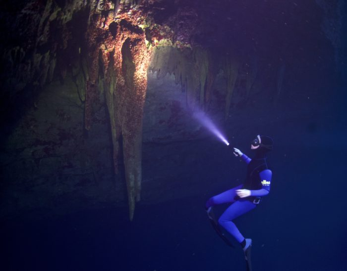 Freediving The Caves of Kefalonia - A stalactite in the dark