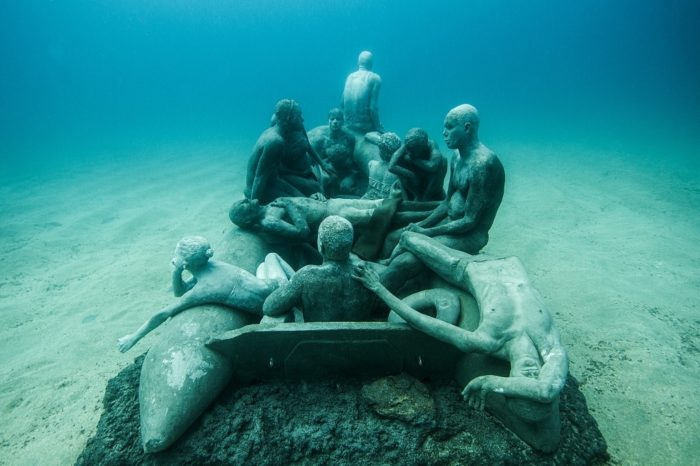 Raft of Lampedusa Sculpture and photograph by Jason DeCaires Taylor