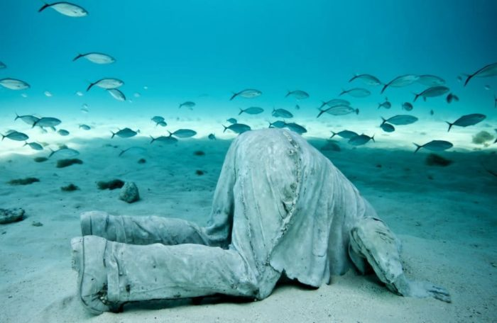 The Banker. Sculpture and photograph by Jason DeCaires Taylor