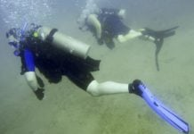Charles James Shaffer swims through the water during his first certification dive as part of the Soldiers Undertaking Disabled Scuba (SUDS) program, US Army Photo
