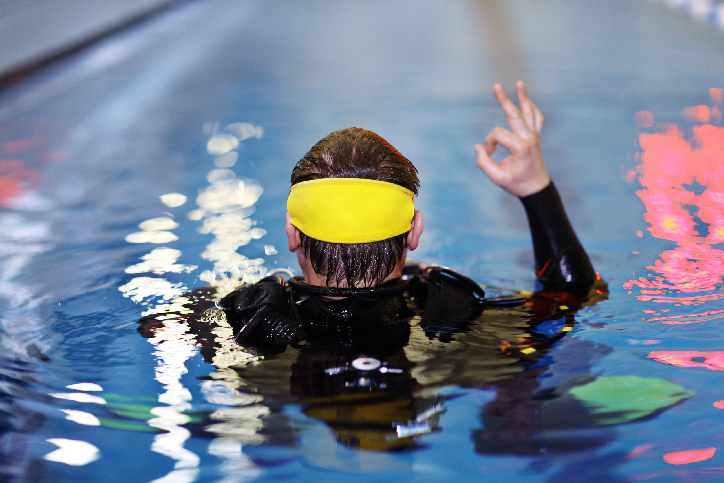 Man giving OK signal in the pool