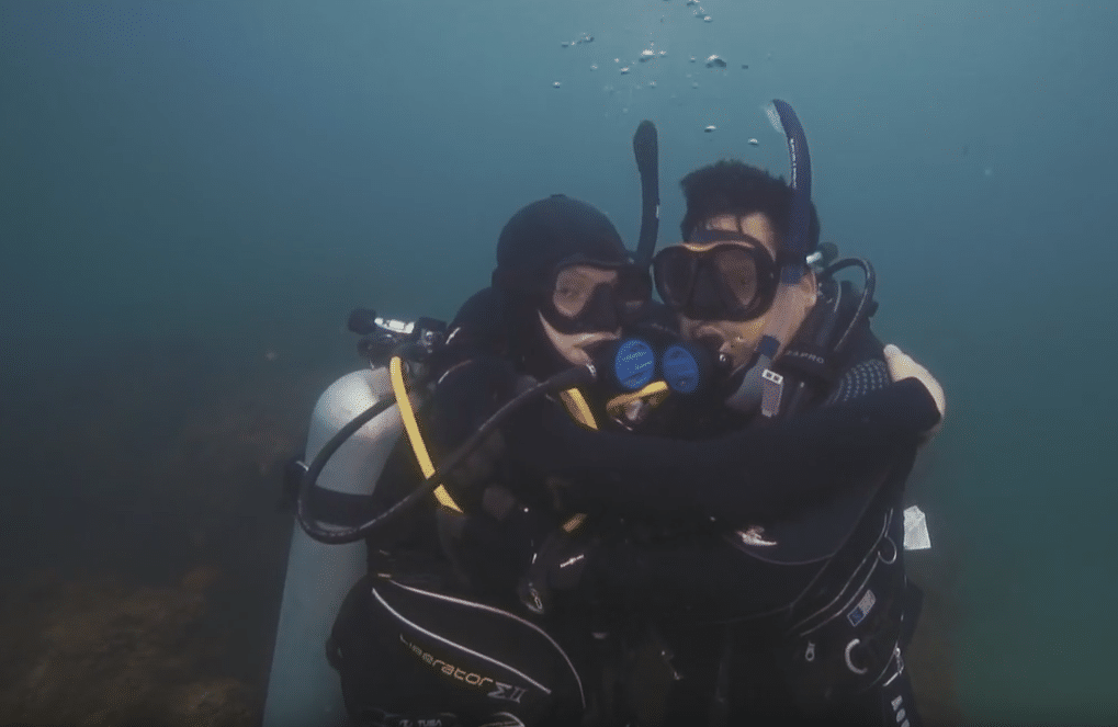 Retired USMC Sgt. Juan Gonzales diving with his son Marcus