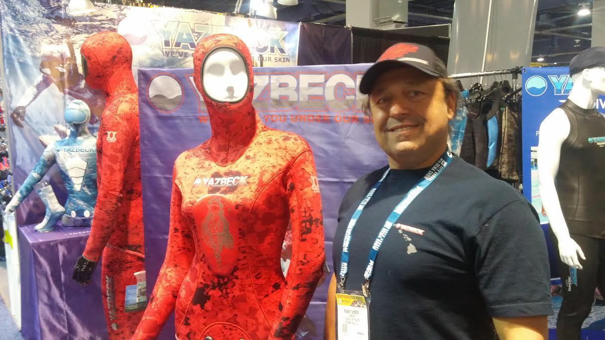 Roger Yazbeck stands proudly next to his women's version of the new Nohu Wetsuit