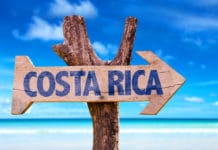 Costa Rica sign with a beach background