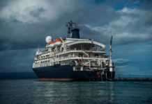 Cruise Ship MV Caledonian Sky Runs Aground Onto Raja Ampat Reef (photo credit: Hugo Mattson)