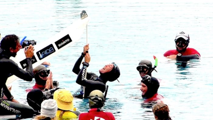 Triumphant and joyful Alessia celebrates at the surface (photo © Ruben Quido)