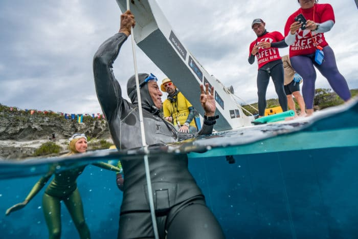 """Mike Board reaching to signal in front of judges """"I am okay!' (photo © Daan Verhoeven)"""