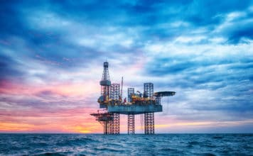 Offshore Jack Up Rig in The Middle of The Sea at Sunset