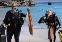 Divers emerging from the sea after a Clean Up dive in Curacao