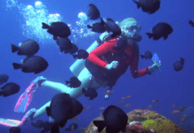 Female Diver celebrating PADI Women Dive Day