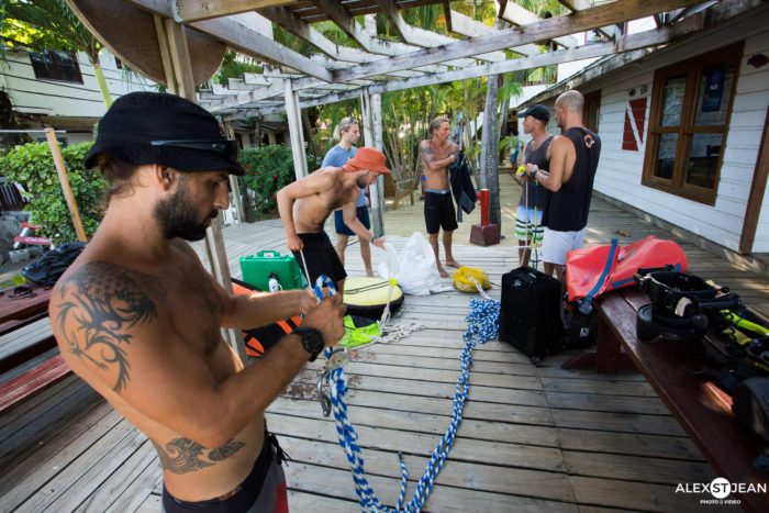 Safety diver, Ariel Kedmi, with crew in back. The behind the scenes action takes the safety team and staff hours past training times.