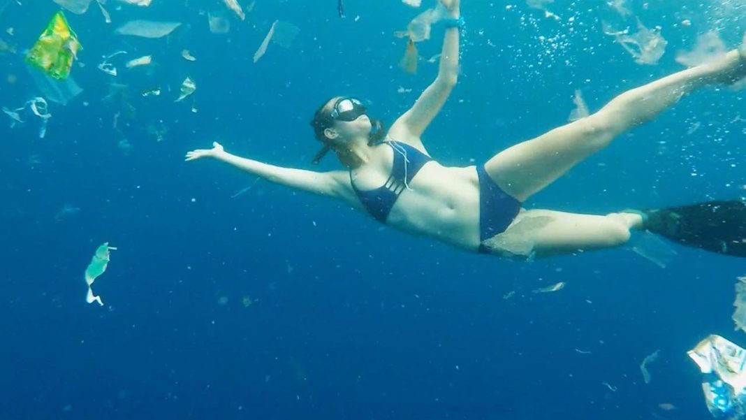 Free-diver Julia Wheeler swims through three tonnes of rubbish in Bali
