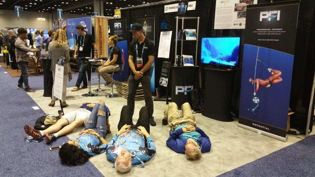 PFI Staff Instructor, Ryan Reed, helps show goers achieve a 3-minute breath hold
