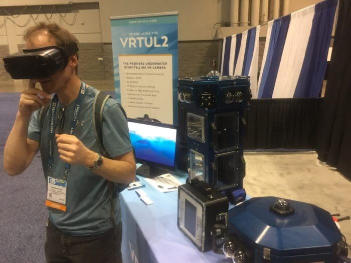 A DEMA attendee gets the full 360 degree experience at the VRTUL booth.