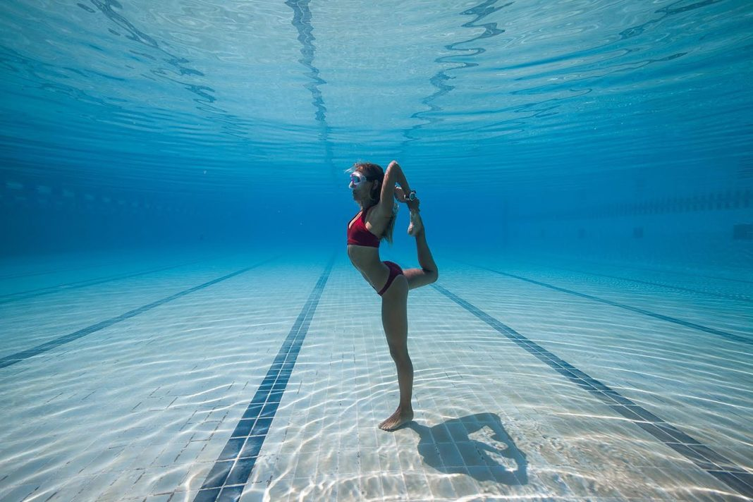 Kate Middleton striking a yoga pose in the pool