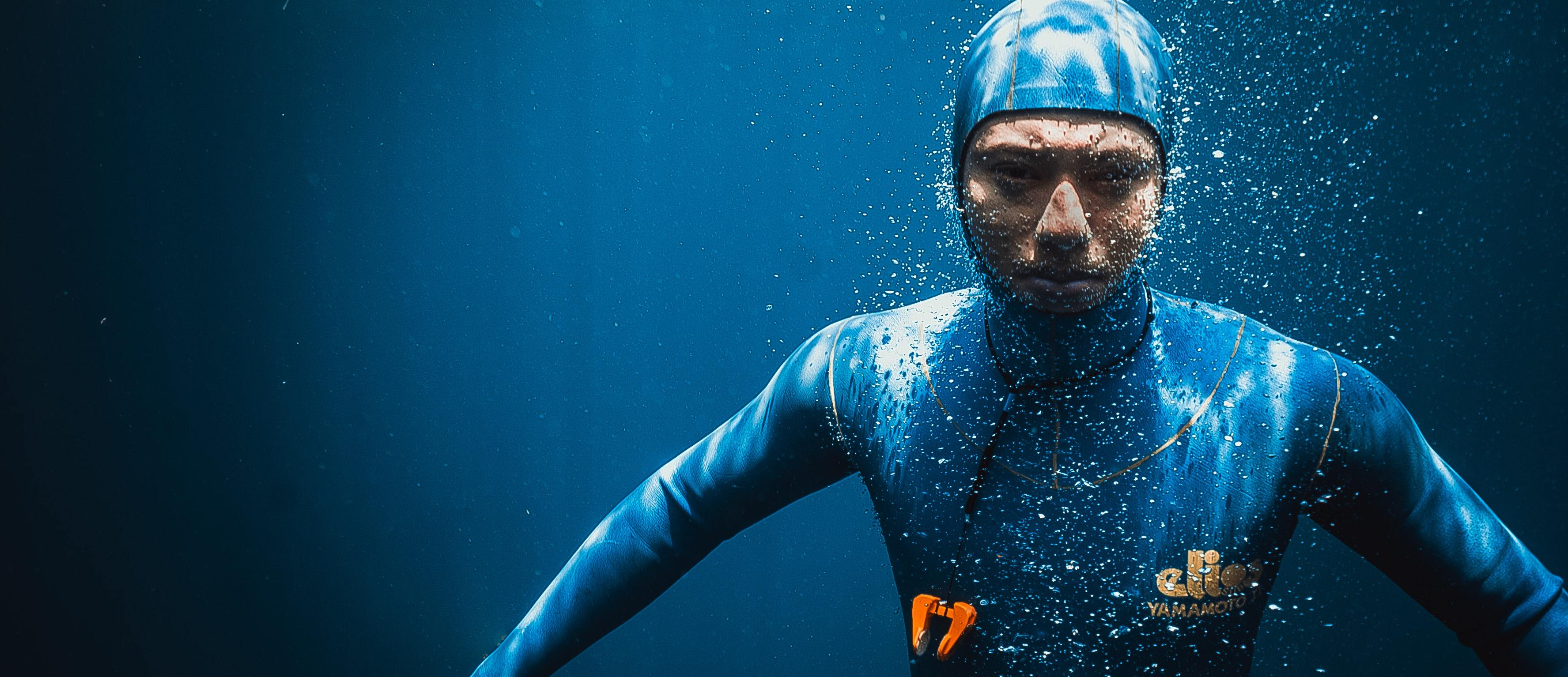 freediver underwater blue wetsuit