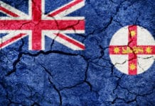 New South Wales flag on dry earth ground texture background