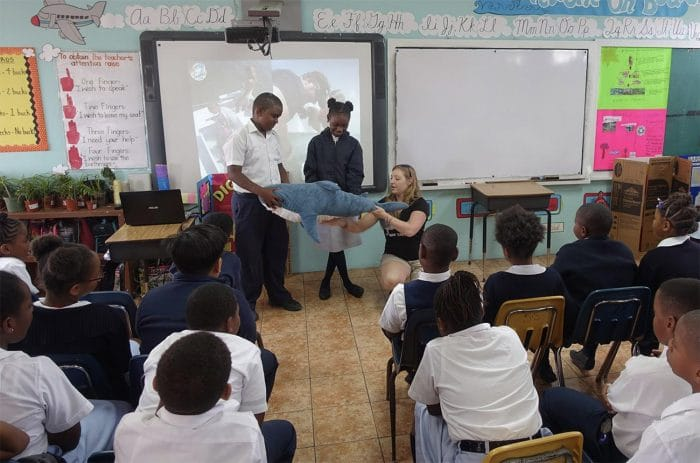 Outreach director Michelle Andersen teaches students about tagging sharks Image: Sharks4Kids