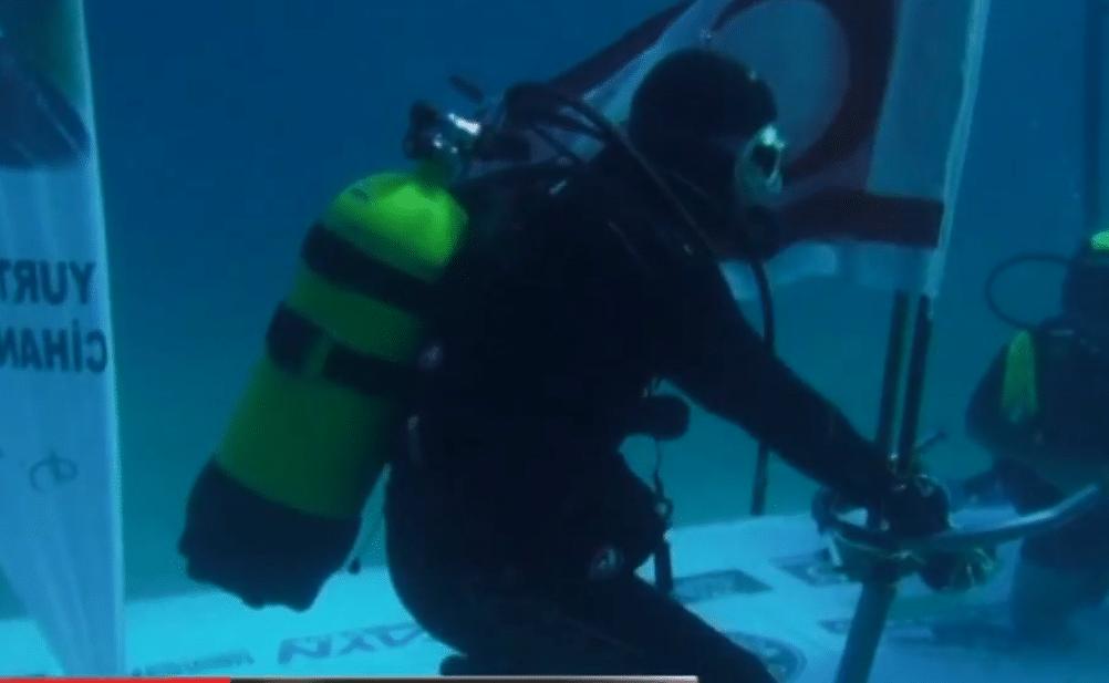 Turkish Diver Cem Karabay sets new cold water endurance record