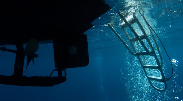 underneath the dive boat where scuba divers return. bubbles can often be seen cascading into the ladder rudder and propeller