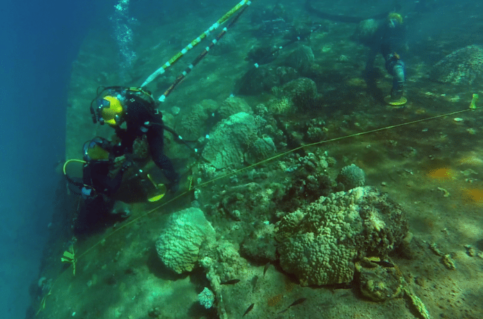 U.S. Navy divers from Mobile Diving Salvage Unit (MDSU) 1, aboard USNS Salvor (T-ARS-52), remove fuel oil from the capsized World War II German cruiser Prinz Eugen. (U.S. Navy photo)