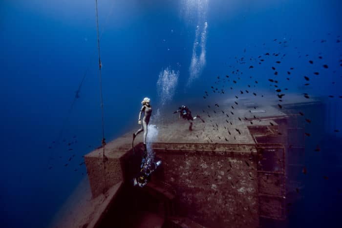 Japanese mermaid and scuba divers at the Zenobia (photo by Daan Verhoeven)