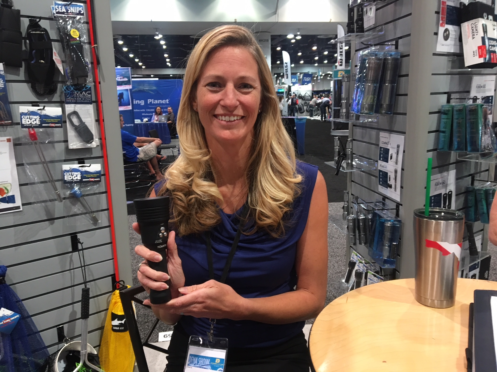 Innovative Scuba Concepts' Jenni Fultz with the Tovatec integrated camera and dive light.