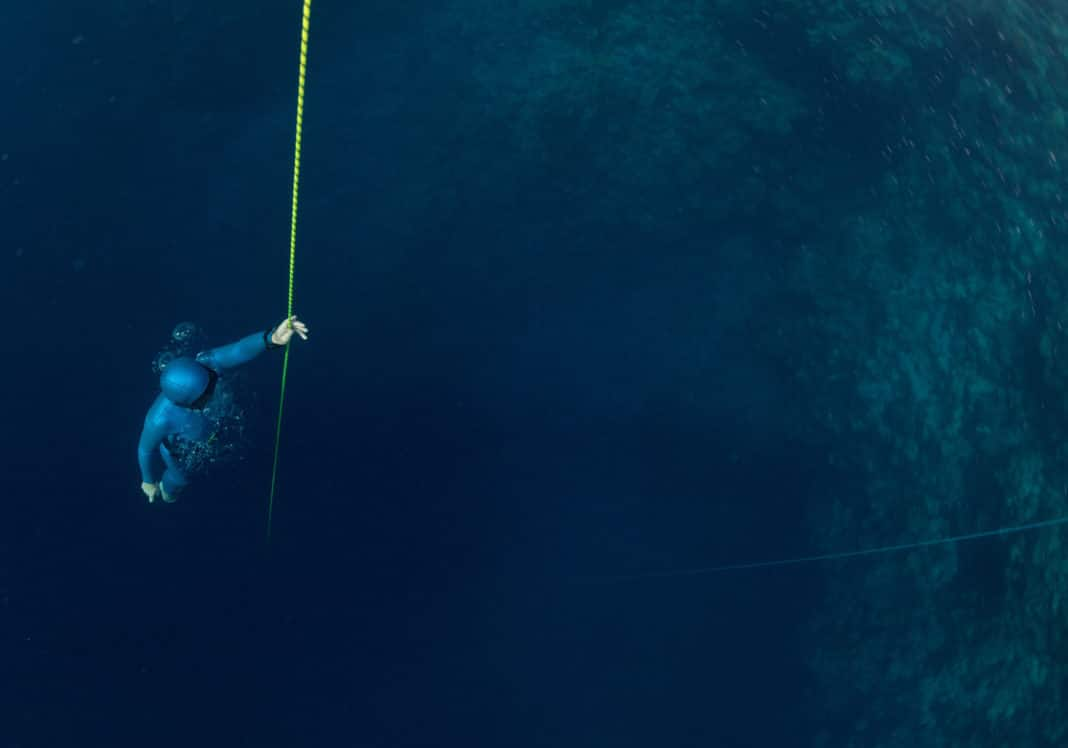 Freediver ascending along the rope