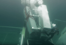 Diver removing missiles from sunken frigate