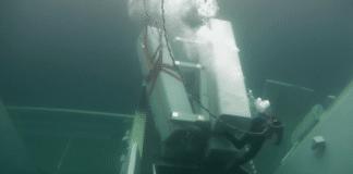 Diver removing missiles from sunken frigate
