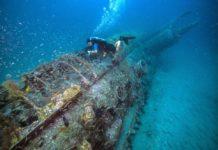 NOAA diver surveys the German U-boat, U-352. Photo: Tane Casserley/NOAA