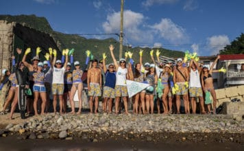Blue Element athletes and crew lend a hand (or two!) for an annual beach clean up in Dominica (photo by Rajiv Smith-Mahabir)