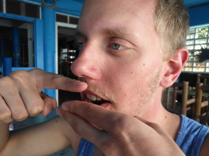 Freediver verifying the soft palate is in a neutral position.