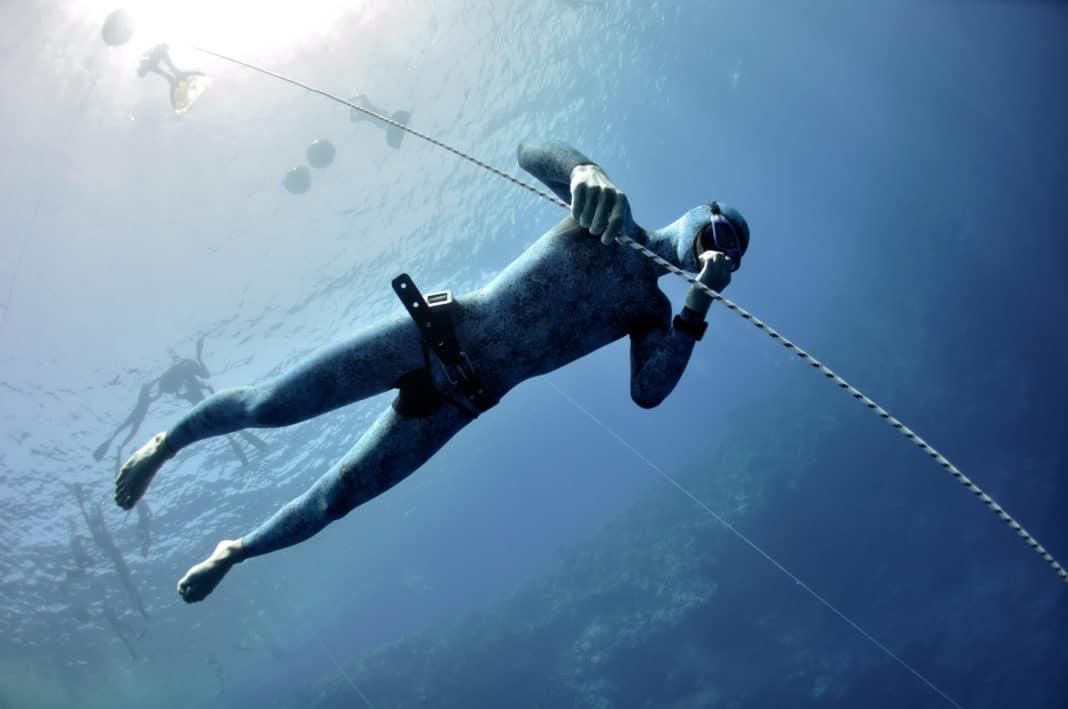 Freediver makes preparation dive in Blue Hole, Dahab, Egypt