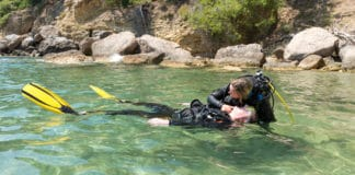 Diver checks casualty for breathing during a rescue practice