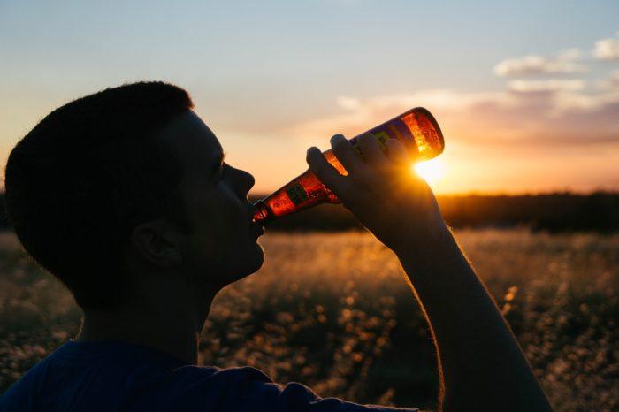Man enjoying a beer at sunset.